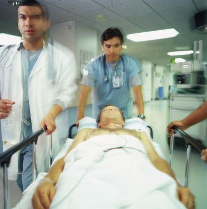 Emergency room doctors with patient