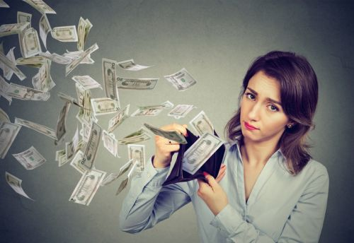 Woman with Money Flying Out of Wallet Because of Bank Overdraft Fees - The Robenalt Law Firm, Inc.
