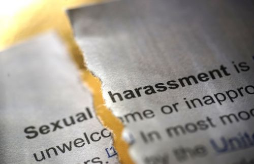 Torn Paper Defining Sexual Harassment - The Robenalt Law Firm, Inc.