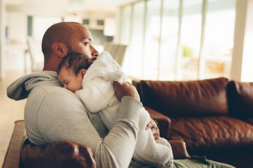 Father with Baby After Maternal Death - The Robenalt Law Firm, Inc.