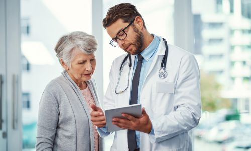 Older Woman Patient Talking to Doctor