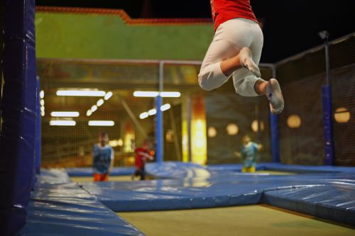 Child jumping on a trampoline inside a trampoline park