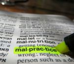 Word Malpractice highlighted in dictionary
